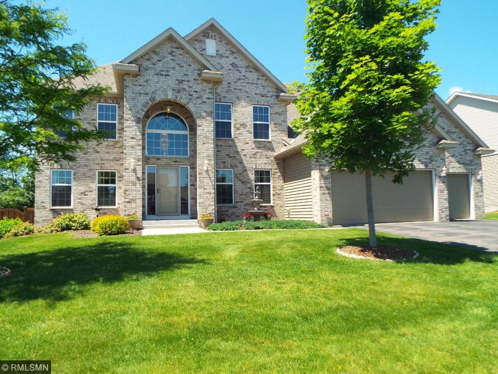 Former Model, Full Brick Front 2 Story with a 3 Car Garage with all 3 levels finished.  Great Multi-generational home with 5 BRs, 5 BAs and 4800+ Finished Square Feet.