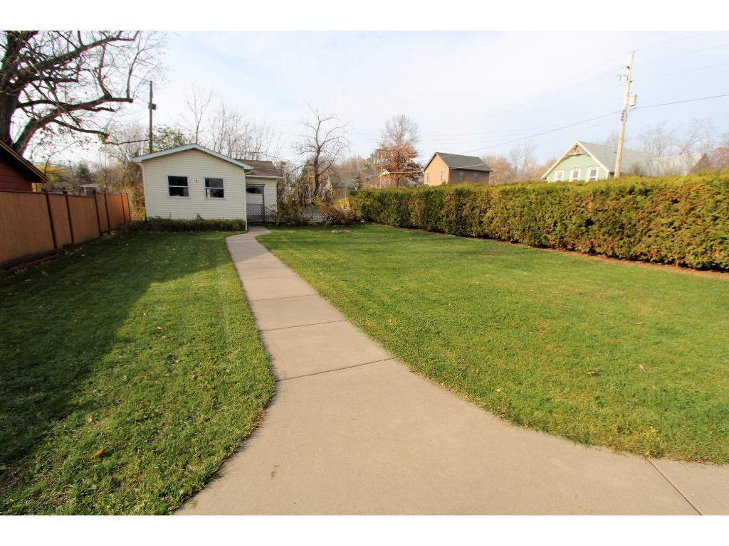 Large corner lot with fenced in yard and bonus room of the oversized 2 car garage.