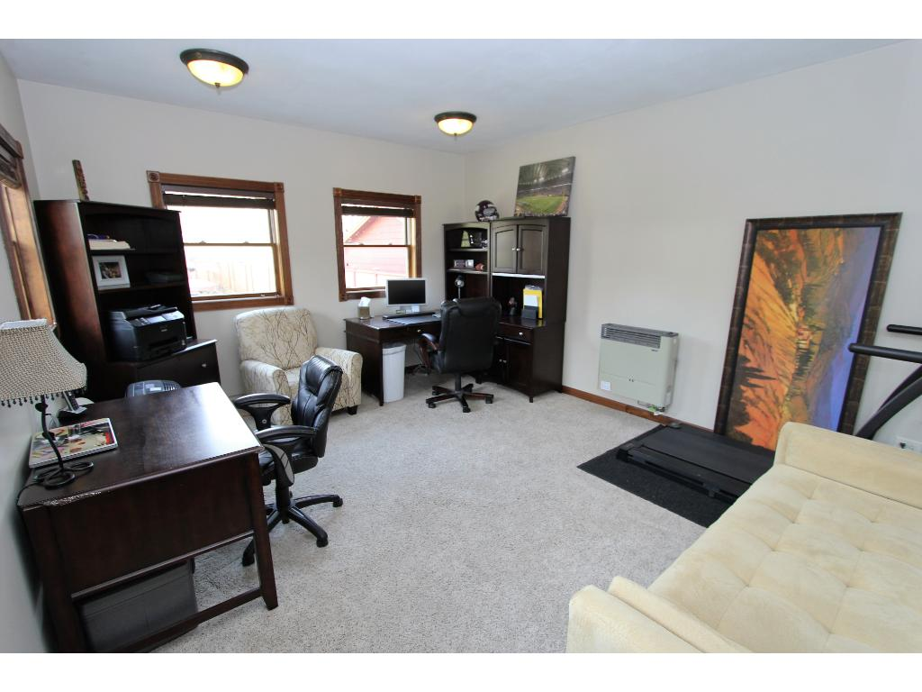 This bonus room is in the detached garage and has heat and A/C. Perfect for an office, workout room, dance studio, playroom, man cave, or much more!
