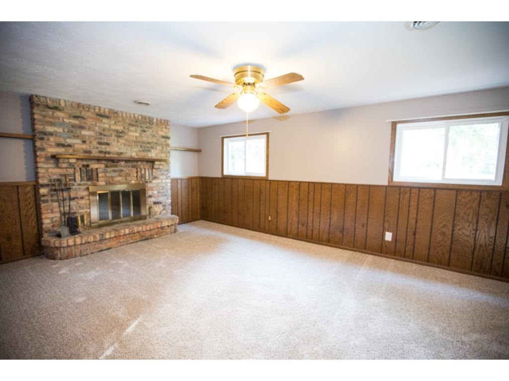 Lower Level Family Room with wood burning fireplace.