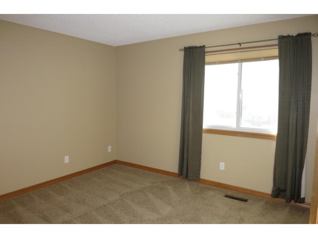 The second bedroom with newer carpeting and a large closet.