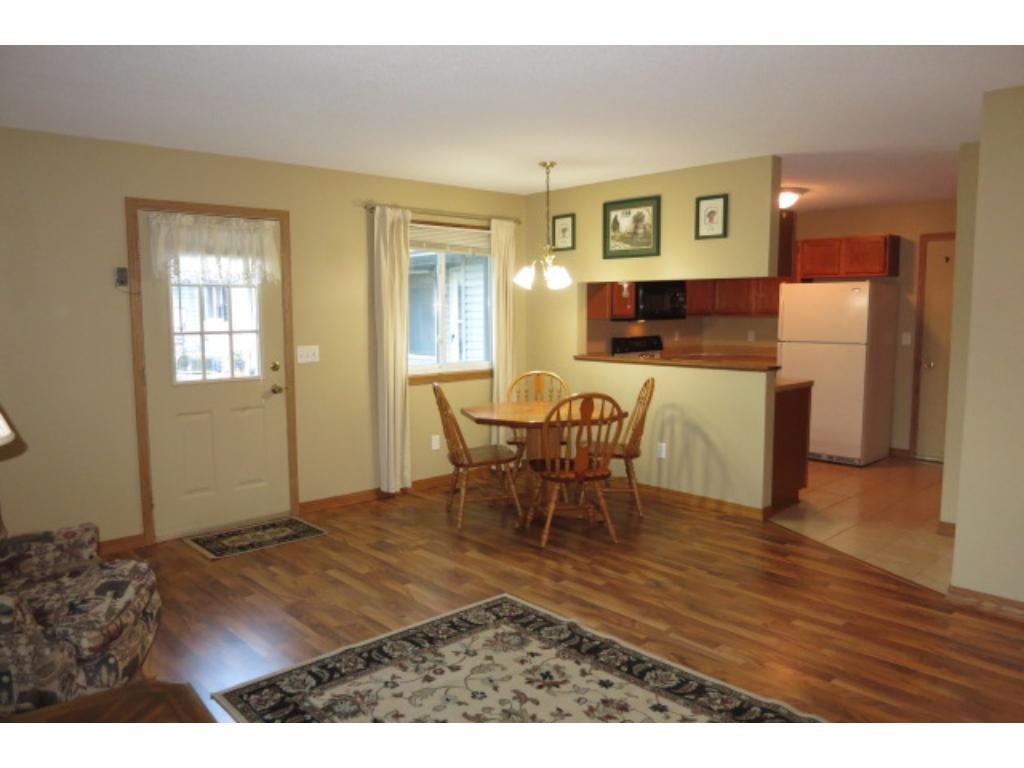 The front entrance is open and has attractive laminate flooring.