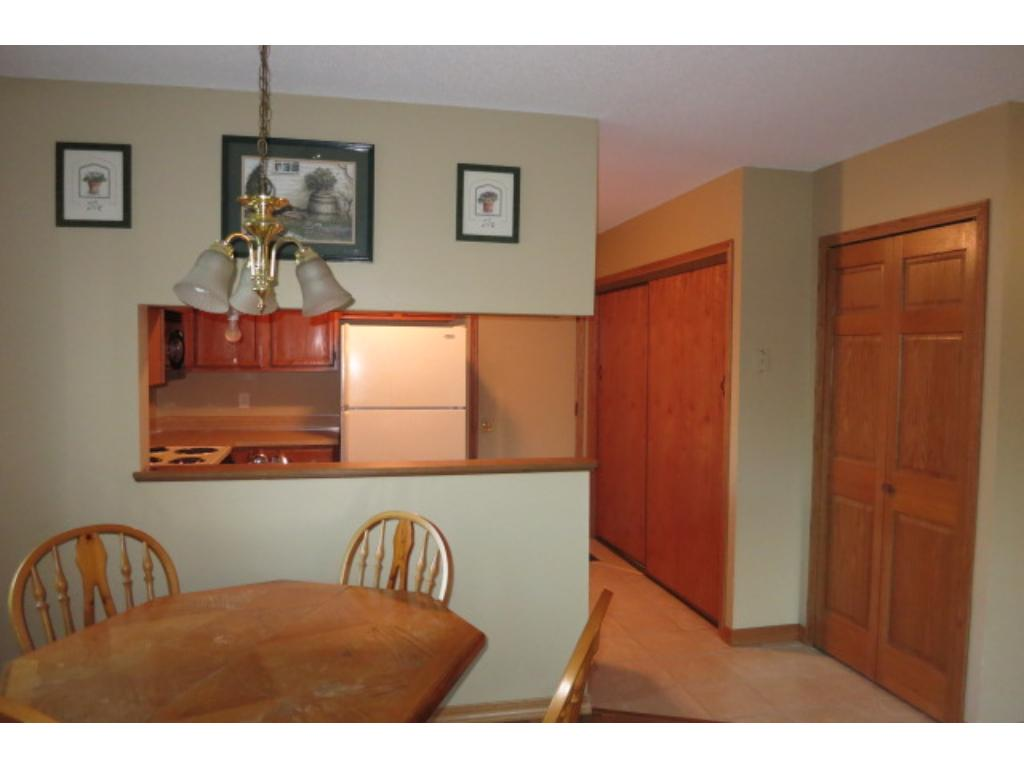 The kitchen/hallway area has the garage entrance door, utility area and a large closet.