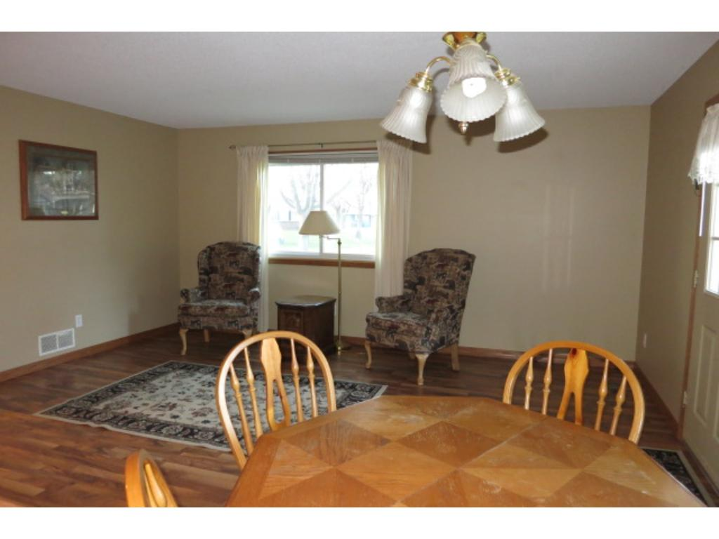 Bright and open living room space with a lot of natural light from the new windows.