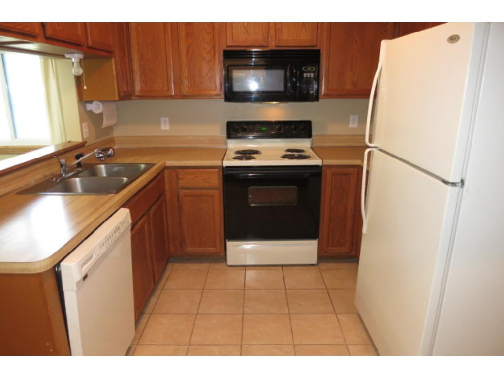 Newer appliances and tile flooring in the kitchen.