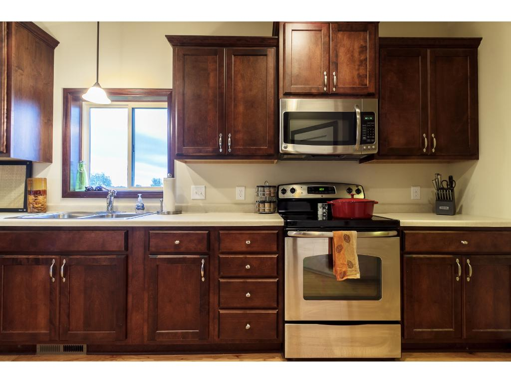 Kitchen window over sink and beautiful cabinetry.
