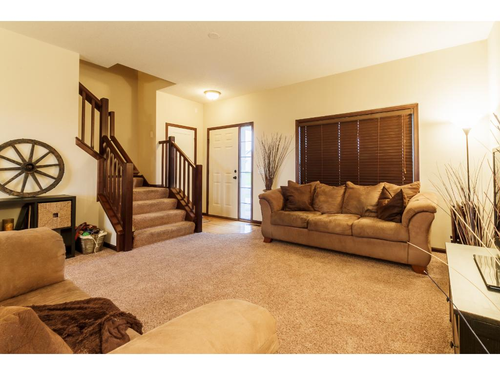 Wide staircase off front foyer and living room