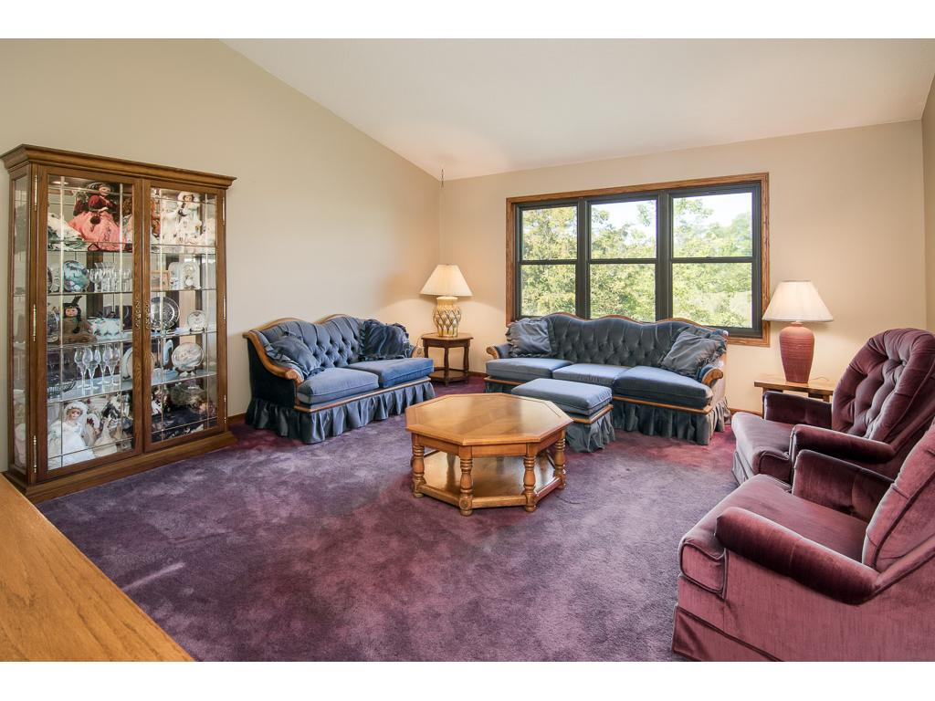 Upper level living room with lots of natural light overlooking the backyard!