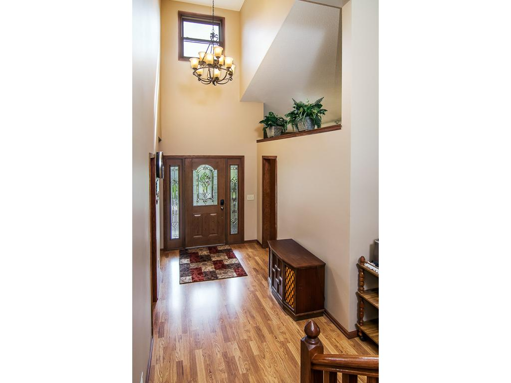 Spacious entry way with garage & closet just off to the right. Easy access to the kitchen!