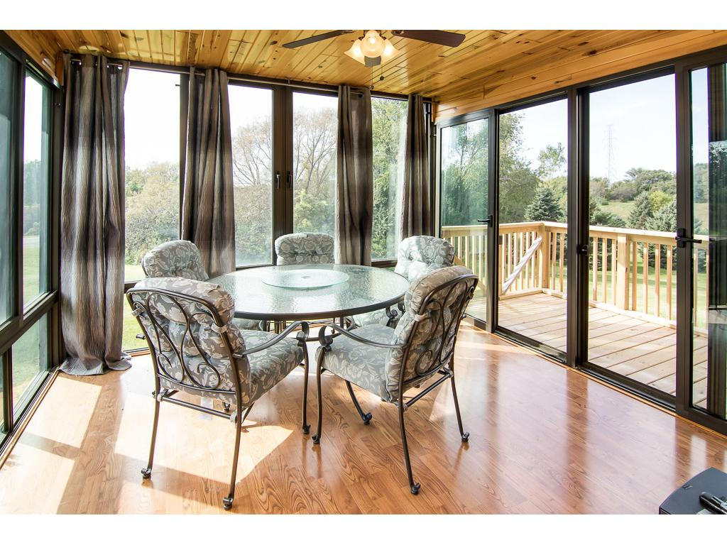 3 Season Porch overlooking the beautiful 5 acres! Plus there is a deck off the porch.