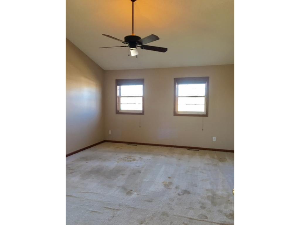 Large master bedroom with large walk in closet. All upper level rooms will need new carpet~