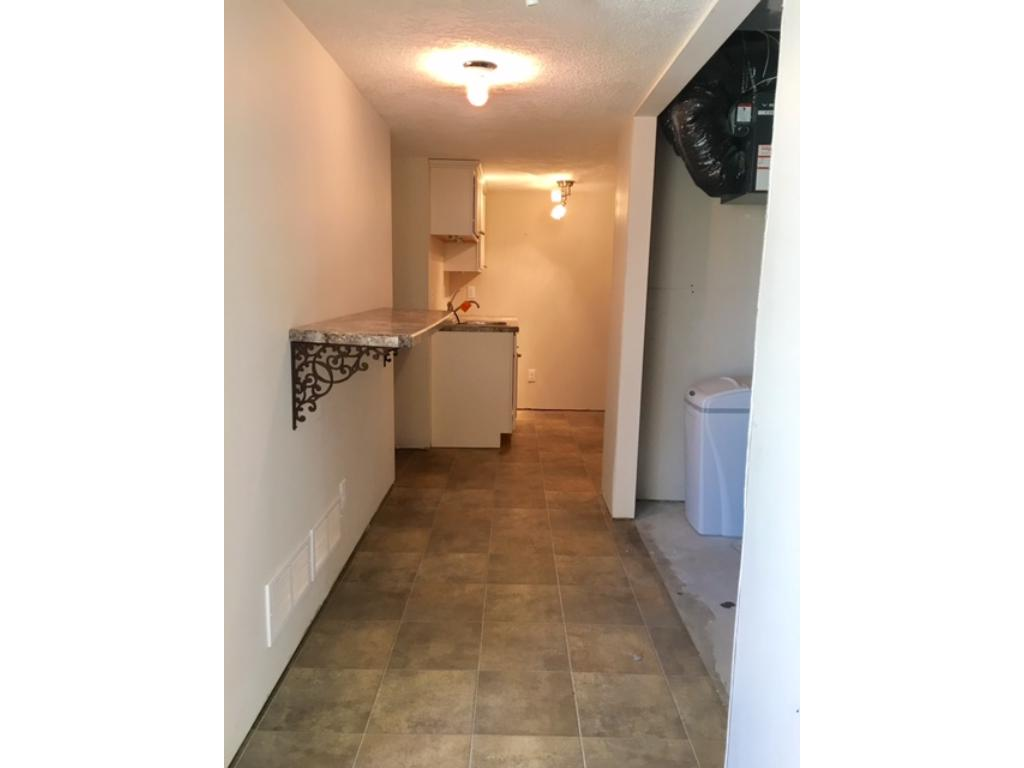 Lower hallway to bath, utility and work space~