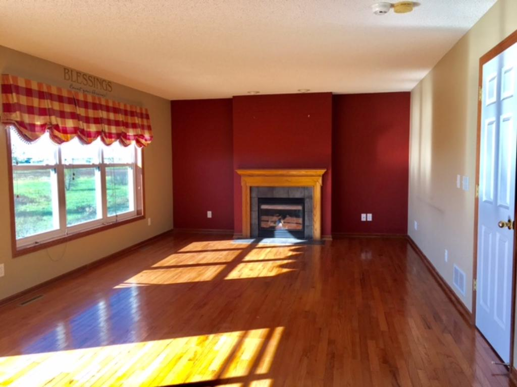 Main floor living room with gas fireplace~