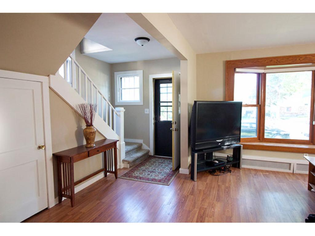 Bright, welcoming entry, opens into roomy living and dining rooms.