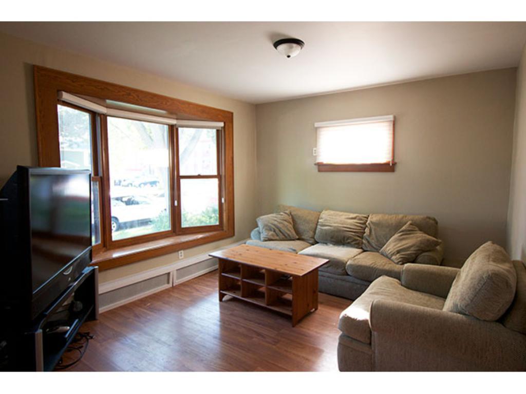 Living Room - Main Level - Large Bay window with window seat!  12' x 13'