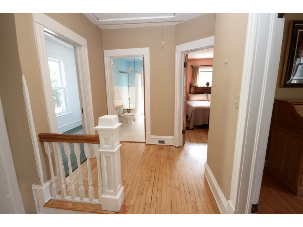 The lovely little landing at the top of the steps with the same gleaming hardwood floors.