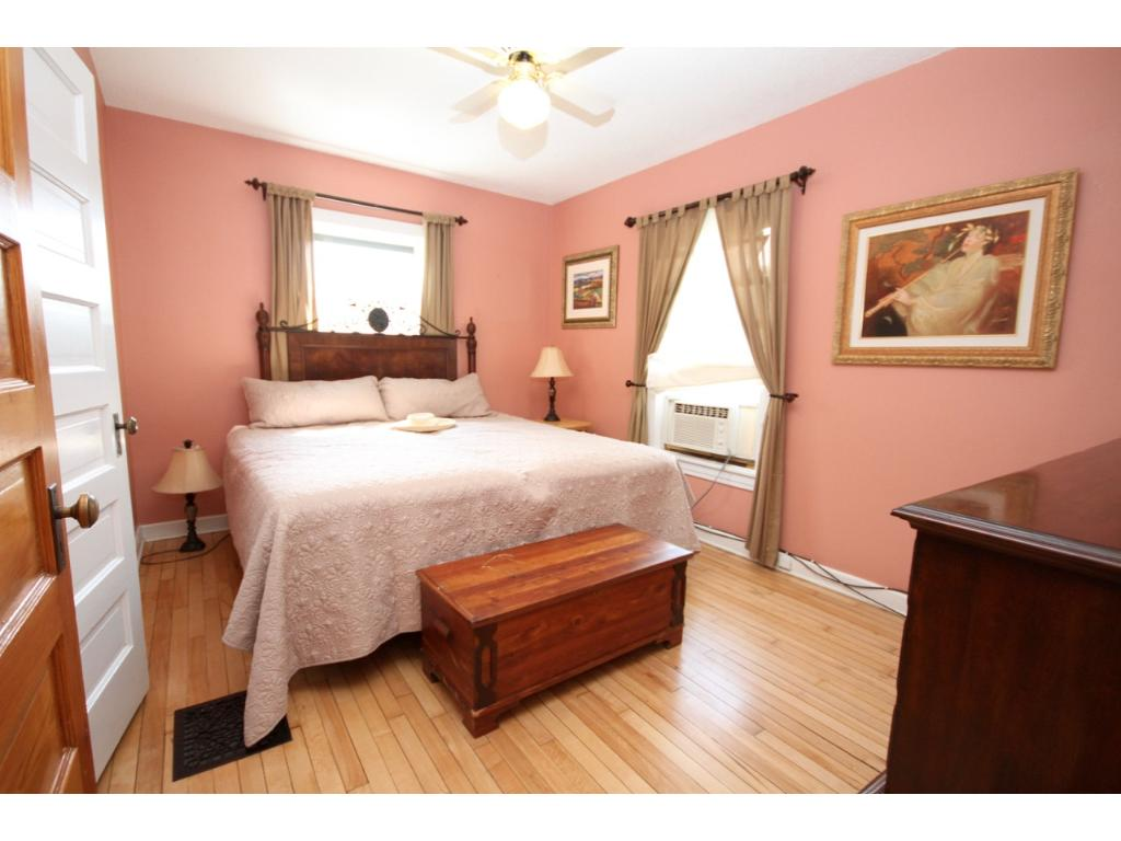 The master bedroom has plenty of room for a king sized bed.