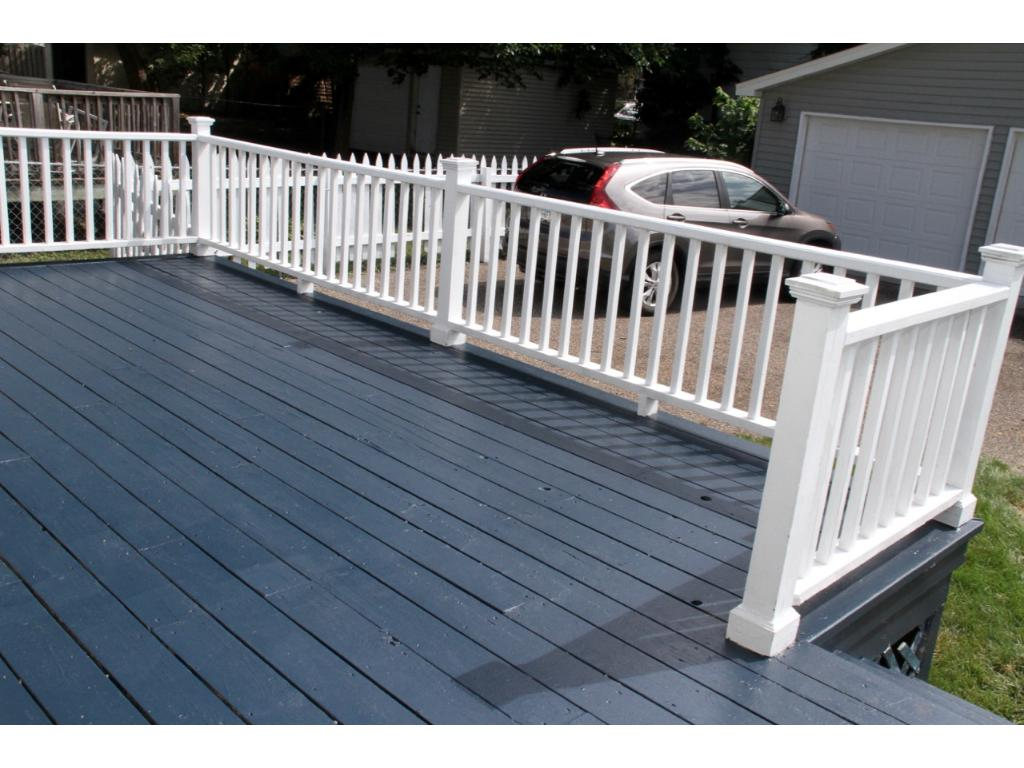 The back porch; the backyard has a white picket fence!