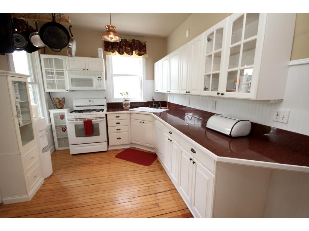 Lovely kitchen with a marble tiled countertop