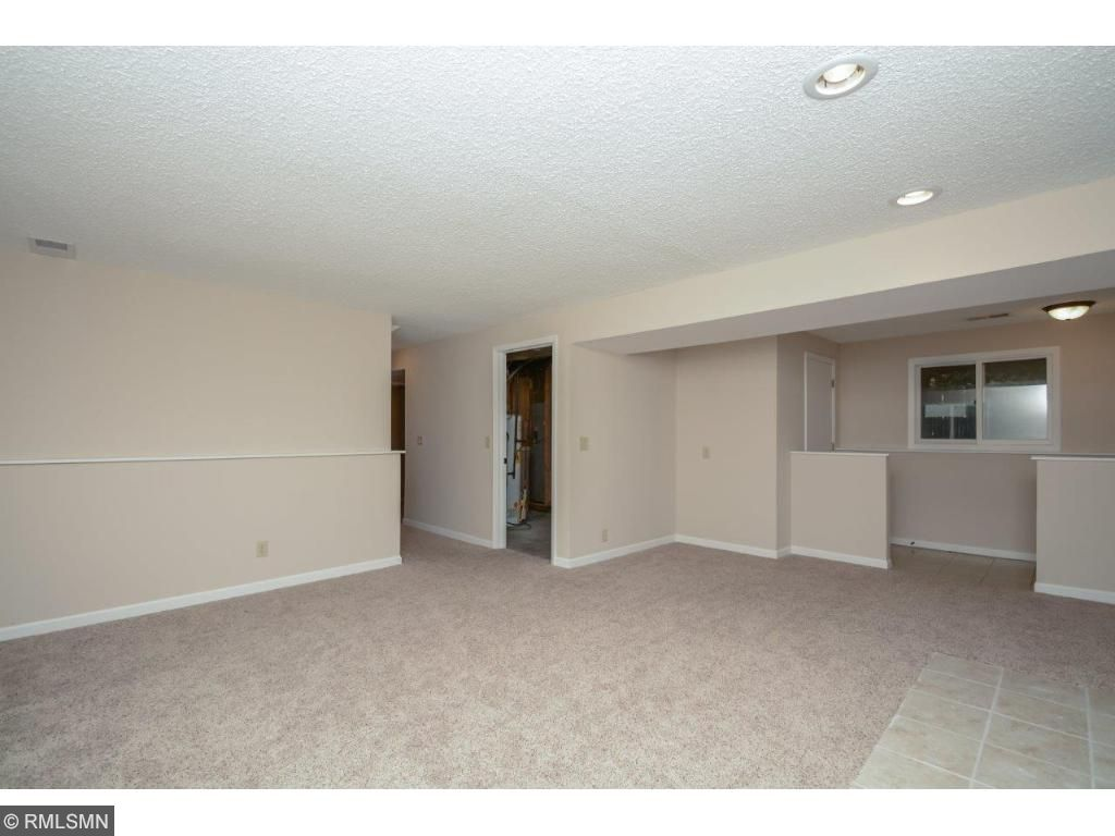 Generously sized family room with access to the garage and utility room!
