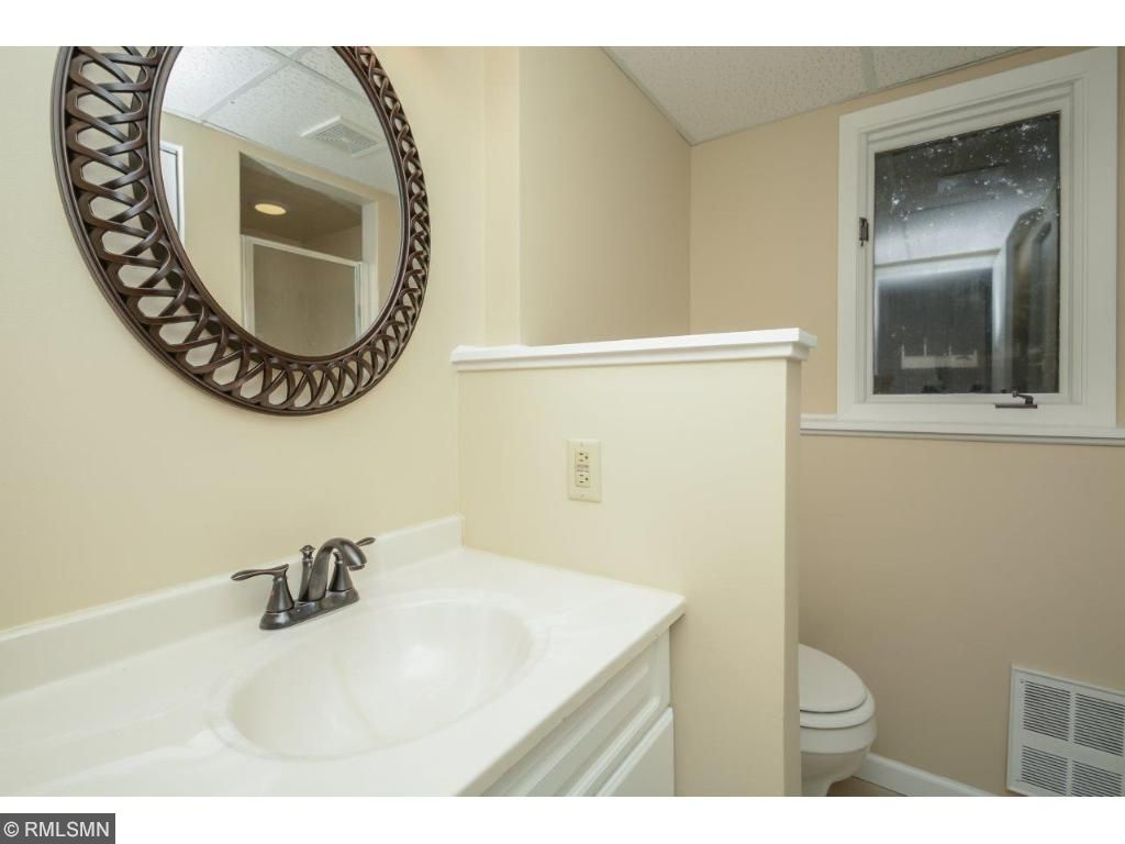 Stunning lower level bathroom with new flooring!