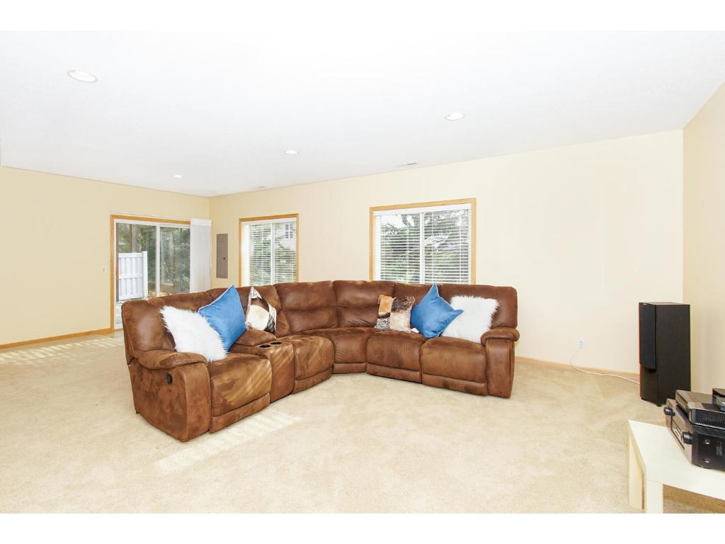 A large family room with plenty of room for family gatherings, games or movies! This room consists of recessed lighting and large windows. Walk out the glass door to enjoy your own private patio.