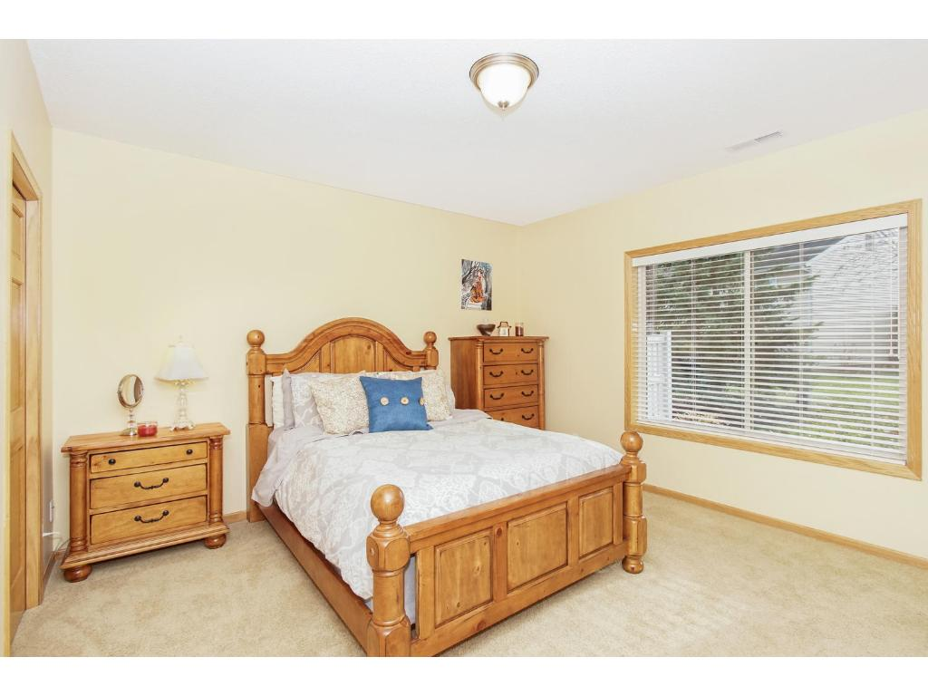 This room is very spacious with neutral decor, very large window with lots of light shining in. Conveniently located next to a 3/4 bathroom.