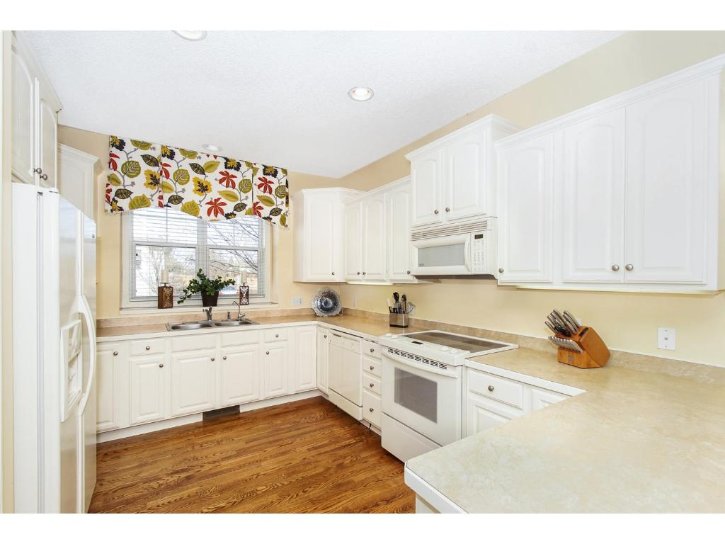 The perfect open layout with white cabinetry, large kitchen windows, recessed lighting, hardwood floors, large pantry, and a breakfast area for sitting. All appliances are included with the home.