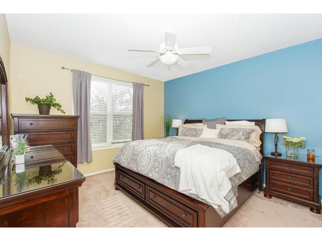 This master suite offers big windows with plenty of natural light and a large walk-in closet.