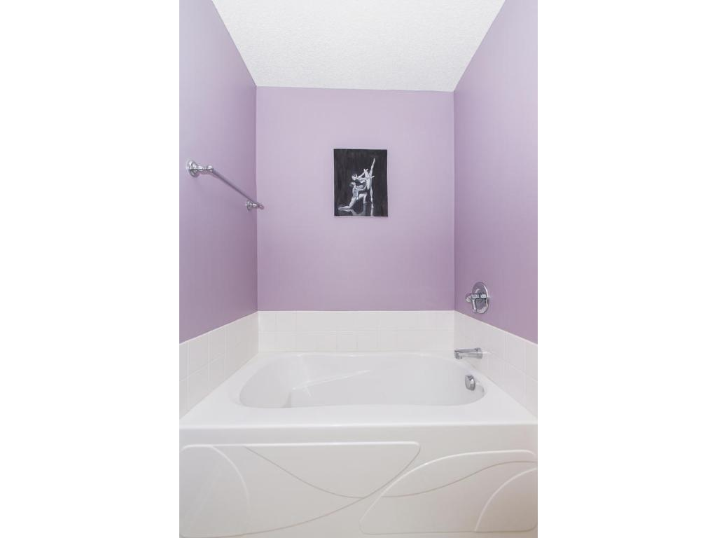 There is a private master bath with double sinks, comfort level countertops, separate shower and deep soaking tub.