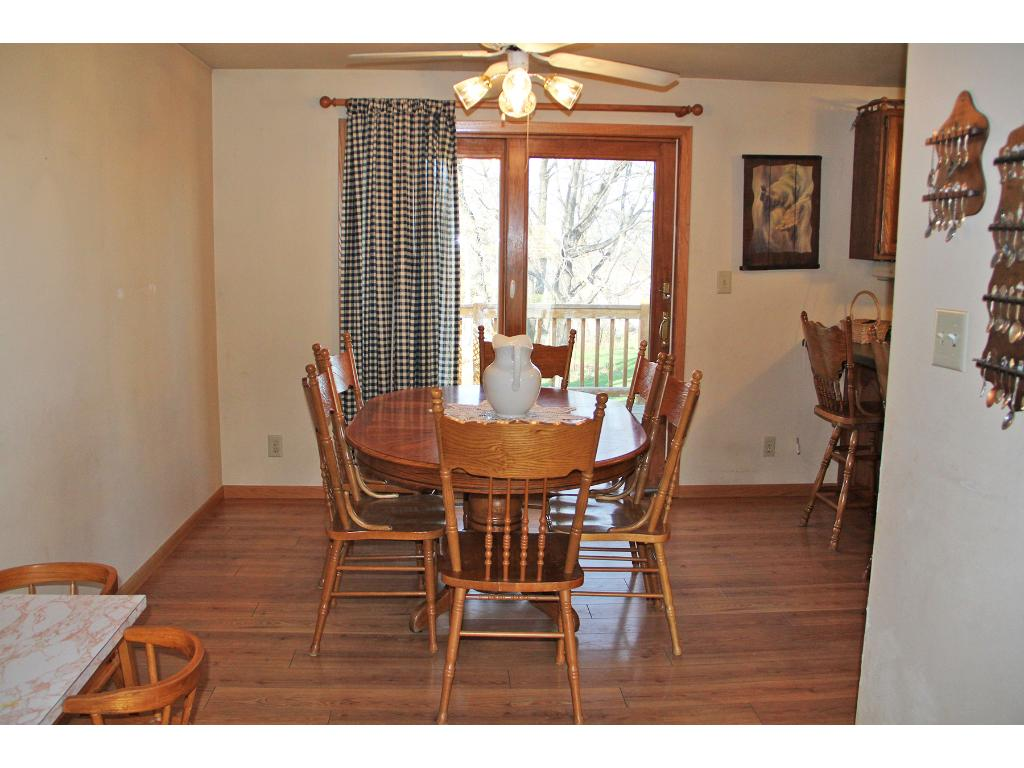 Dining area open the kitchen and has a patio door that leads to the backyard deck