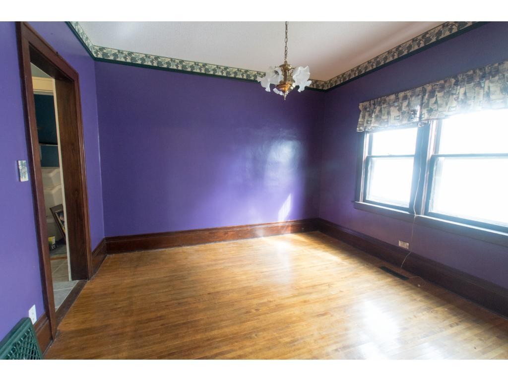 Formal dining room adjacent to kitchen. Original hardwood floors.