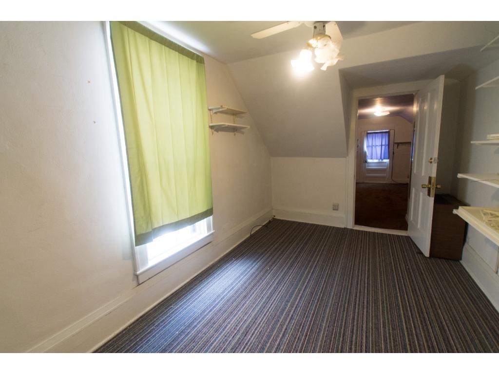 Upper master bedroom sitting area. Master bedroom through doorway.