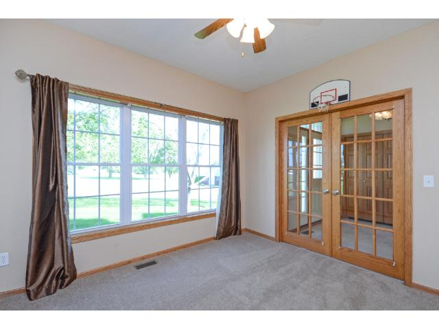 French doors off the front entry to the office space creates a quiet retreat to work or for students to do homework.