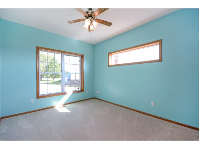 Second main floor bedroom.  Privacy window across top.  New carpet in hall and all main bedrooms. This home is move in ready.