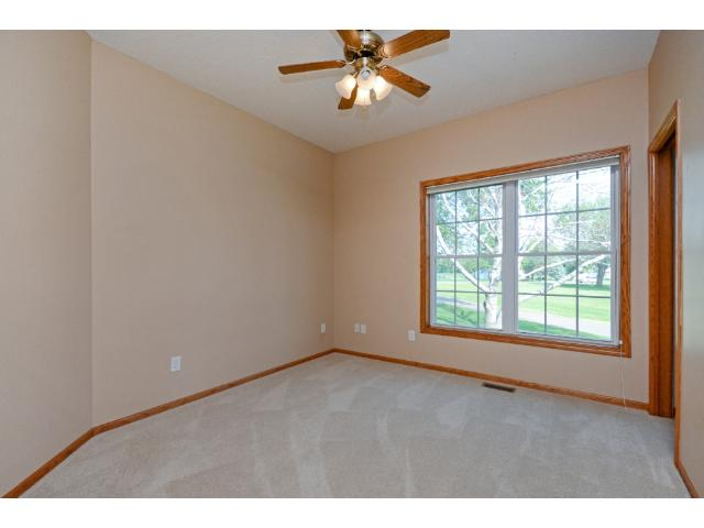 Large bedroom on main makes 3.  The wide and tall windows allow natural light to flood the room.