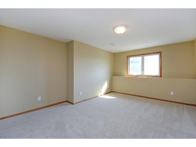 Large bedroom in lower level.  The lower level with separate entry could be used as mother-in-law apt. or part of your business plan.