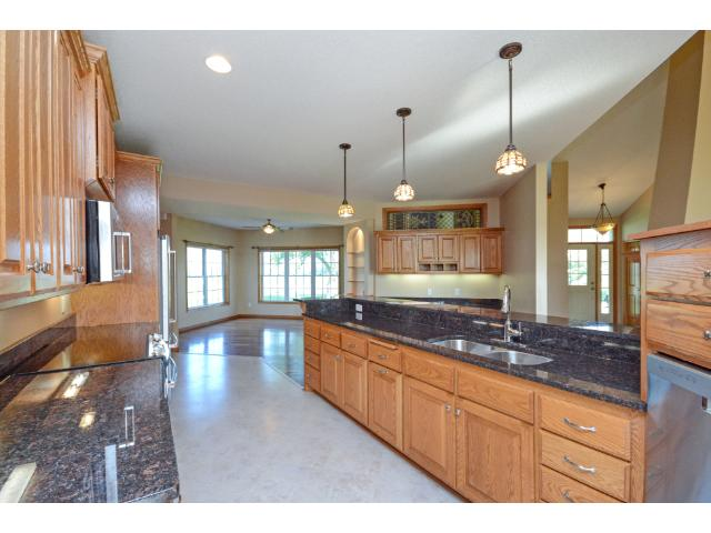 Granite counter tops, stainless steel appliances in a spectacular kitchen that opens to the main living area.