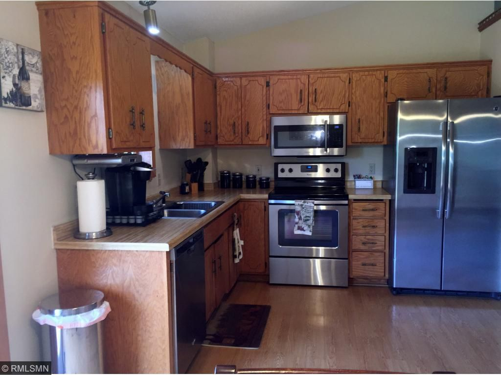 The kitchen is nice and open and features all new stainless steel appliances.