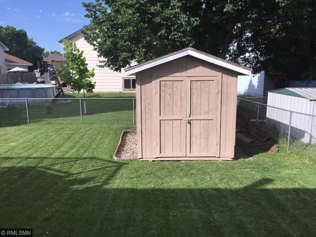 Plenty of extra storage space for your outdoor items with this large shed in the backyard.