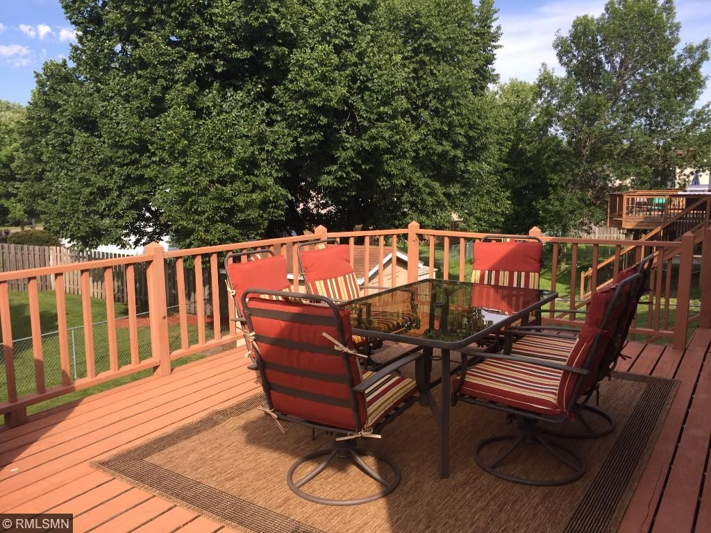 Relax on your large deck overlooking the fully fenced backyard.