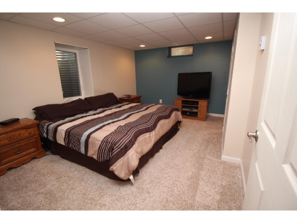 One of two main level bedrooms with new carpet, trim, closet doors & fresh paint.