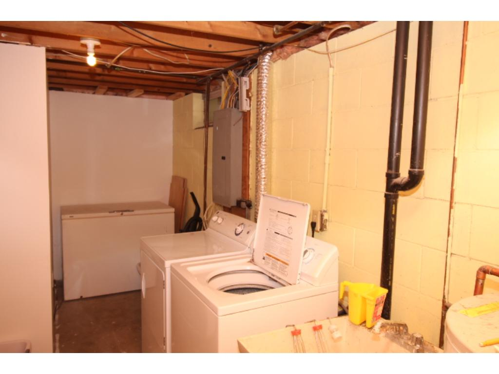 Main level full bath with new flooring, toilet & vanity.