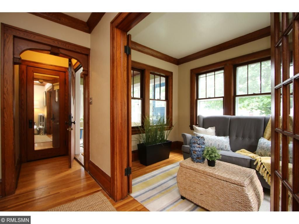 Cozy sunroom with lovely french doors!