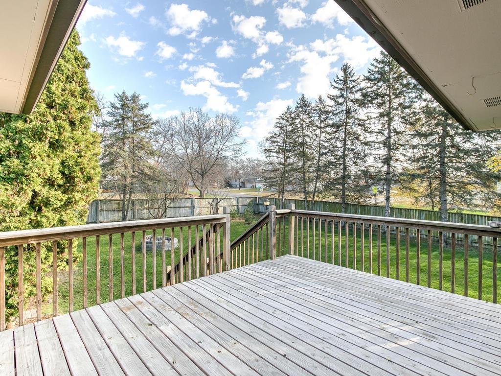 Huge deck overlooking private backyard