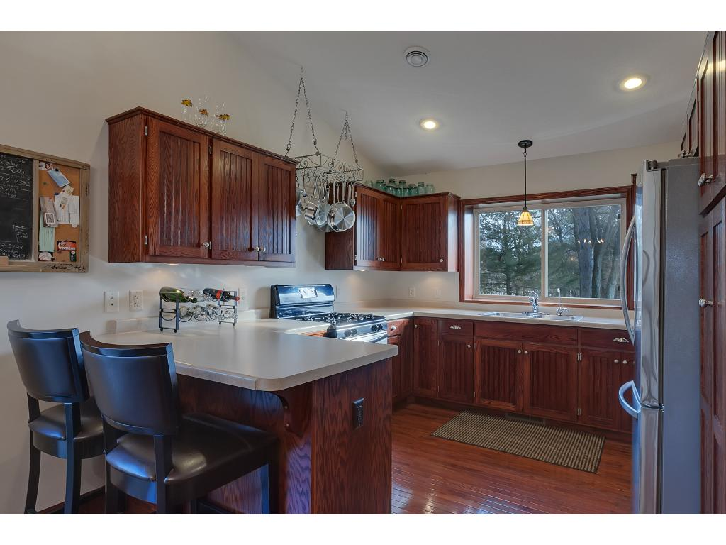 The kitchen features recessed lights and a vaulted ceiling.  All stainless steel appliances will stay with home.