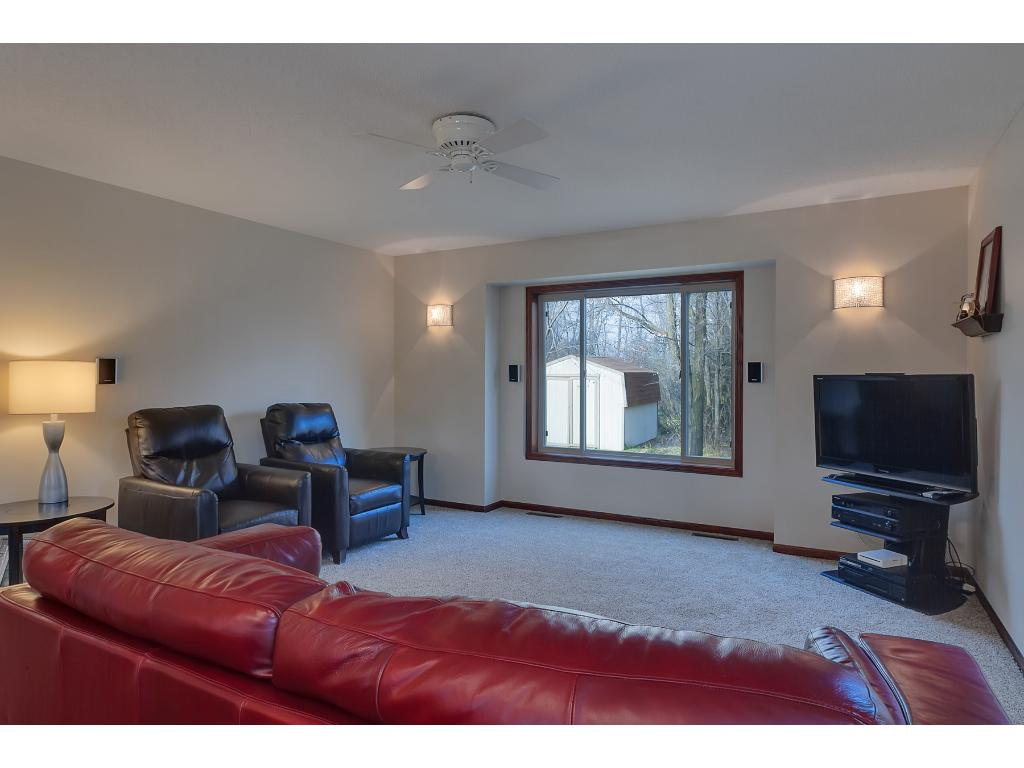 The living room also features a ceiling fan and NEW carpeted flooring.
