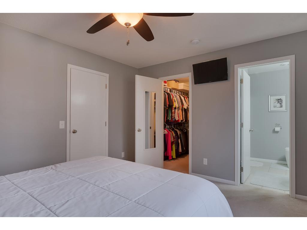 The master bedroom also features a walk-in closet and a private bath.