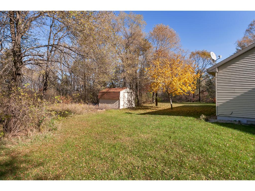 The accessory outbuilding measures 10'x12' sits in with some of the beautiful mature trees on this 2.5 acre lot.