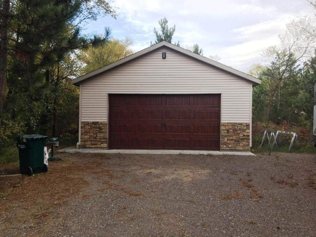 You'll notice the garage door and stone accent on the front of the detached garage here match the house.
